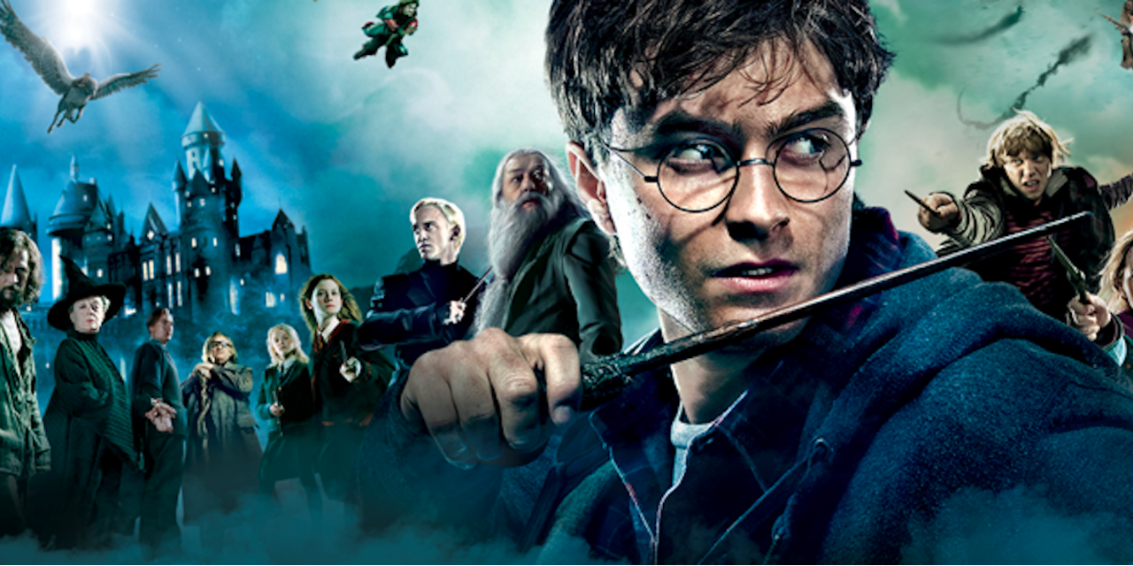 Harry Potter holding his wand.